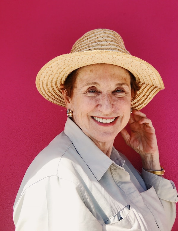 older woman in hat smiling